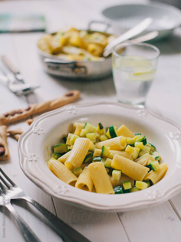 Macaroni with zucchini by Davide Illini for Stocksy United