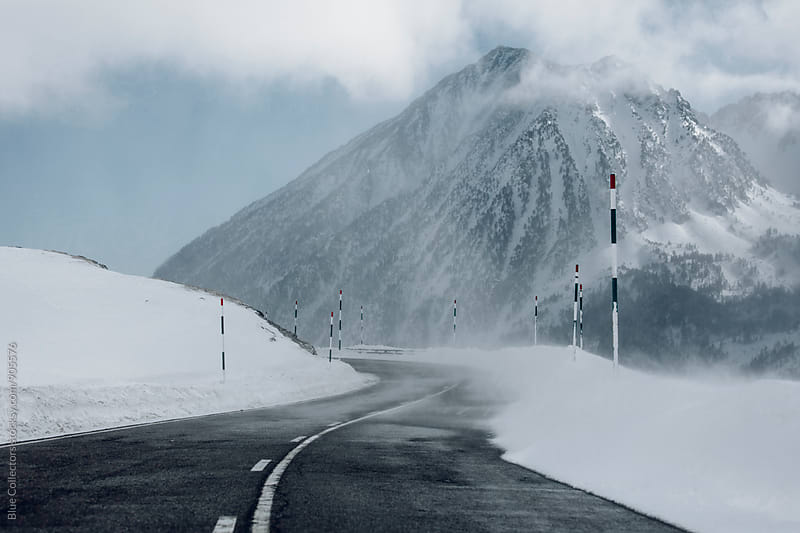 Winter road in the snowy mountain by Blue Collectors for Stocksy United