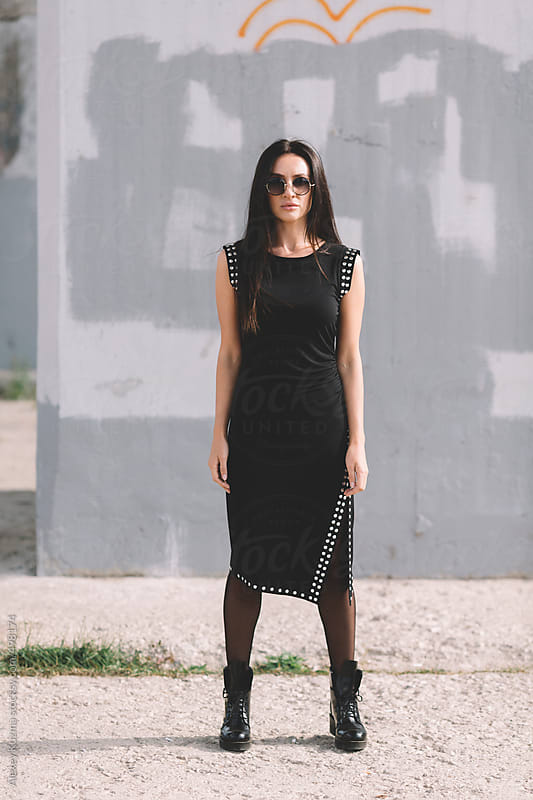 beautiful young woman wearing black dress. by Alexey Kuzma for Stocksy United