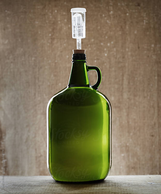 Still life of fermented pear cider in glass bottle  by Trinette Reed for Stocksy United