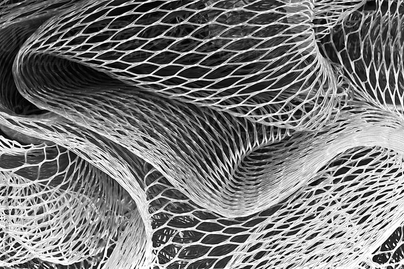 Closeup macrophotograph of plastic mesh material by Ron Mellott for Stocksy United