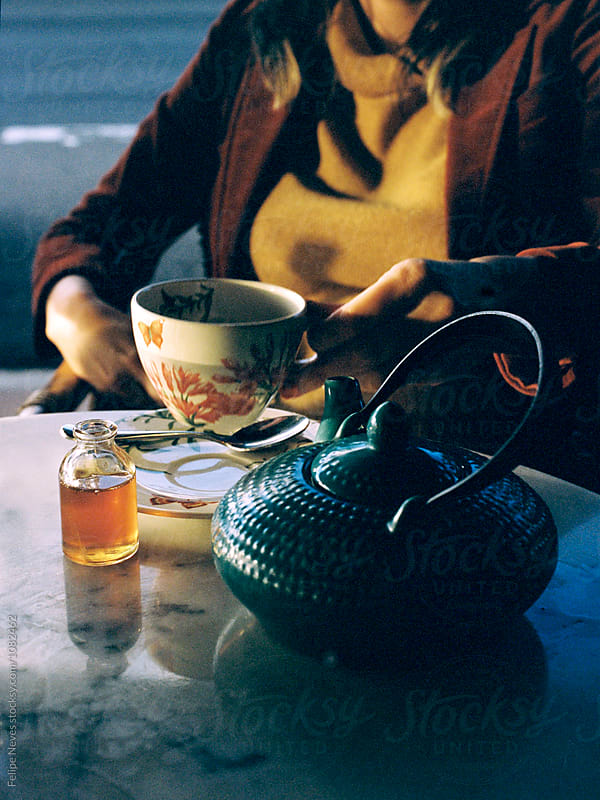 Woman drinking tea by Felipe Neves for Stocksy United
