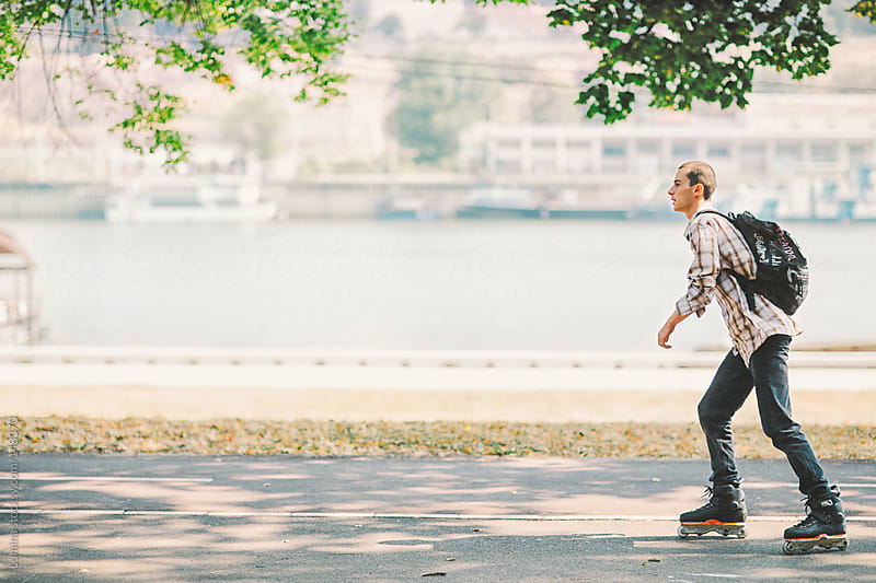 Roller Skating by the River by Lumina for Stocksy United