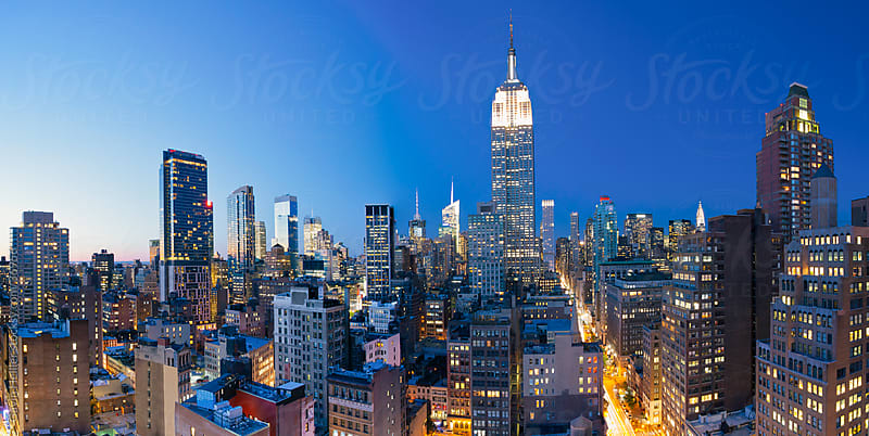 Midtown Manhattan, elevated dusk view towards the Empire State Building, Manhattan, New York City, New York, United States of America by Gavin Hellier for Stocksy United