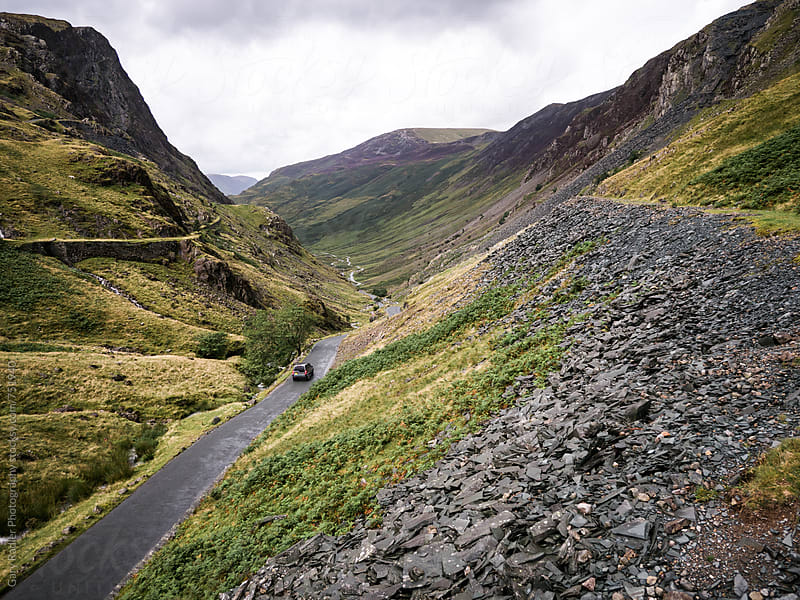 4WD travelling down Honister Pass, Lake District, England by Gary Radler Photography for Stocksy United