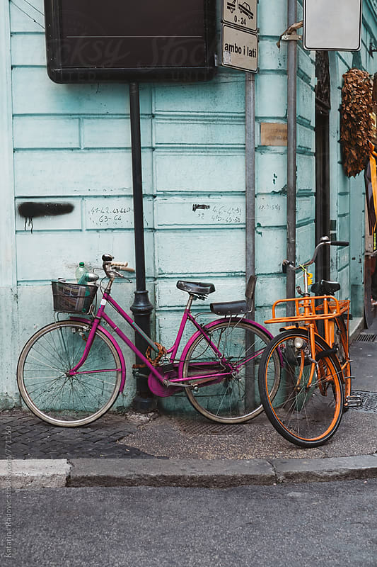 Colourful Bicycles in front of the Pastel Blue Facade on a Street by Katarina Radovic for Stocksy United