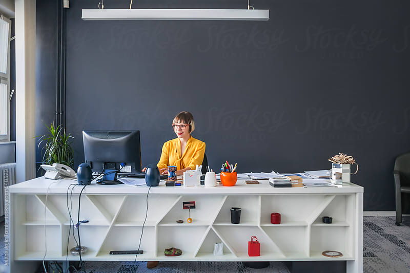 Businesswoman at her office by Jelena Jojic Tomic for Stocksy United