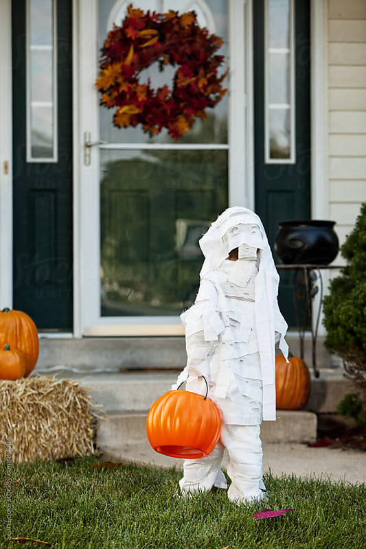 Halloween: Boy Mummy Walks Towards Front Door by Sean Locke for Stocksy United