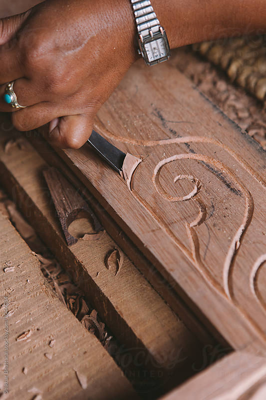 Hands carving wood. by Shikhar Bhattarai for Stocksy United