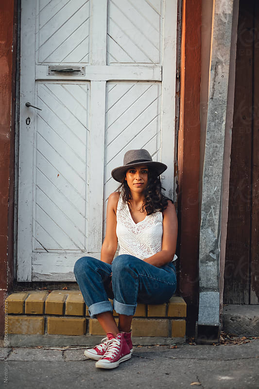 Beautiful Bolivian Teen With Hat Sitting in Old Town by Nemanja Glumac for Stocksy United