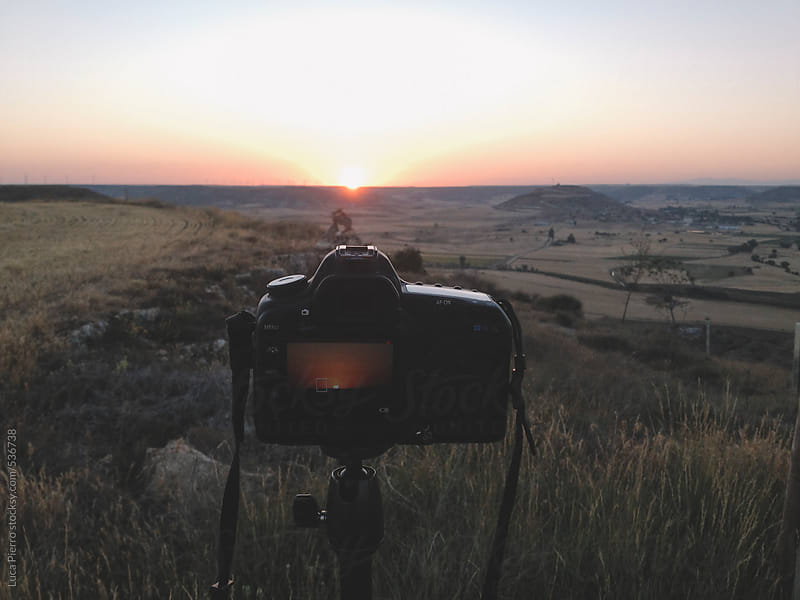 Digital camera capturing sunrise in the Spanish Mesetas by Luca Pierro for Stocksy United