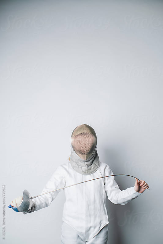 Professional female fencer holding sabre by Danil Nevsky for Stocksy United