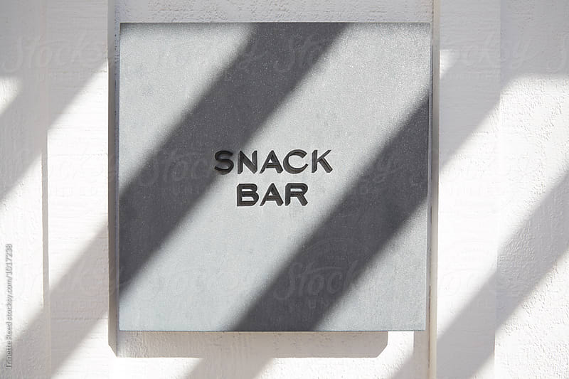 Snack bar sign at pool by Trinette Reed for Stocksy United