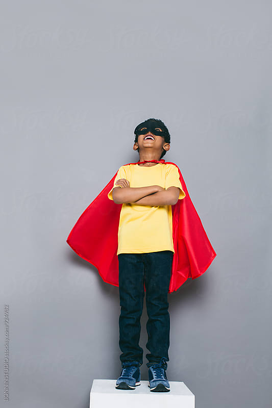 Laughing little boy with Superhero costume. by BONNINSTUDIO for Stocksy United