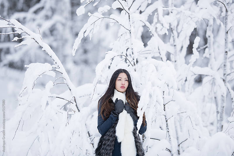 asian winter lady by Andreas Gradin for Stocksy United