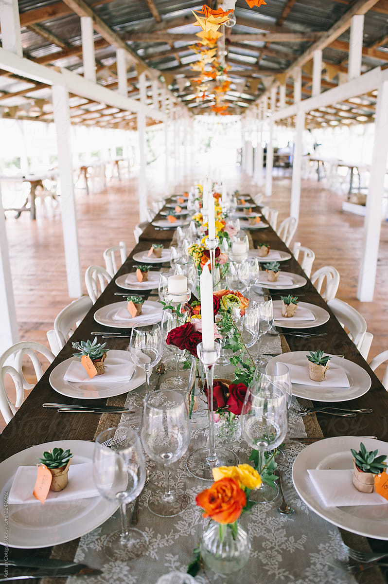 Table setup , Wedding Table Setting by Adrian Cotiga - Stocksy United