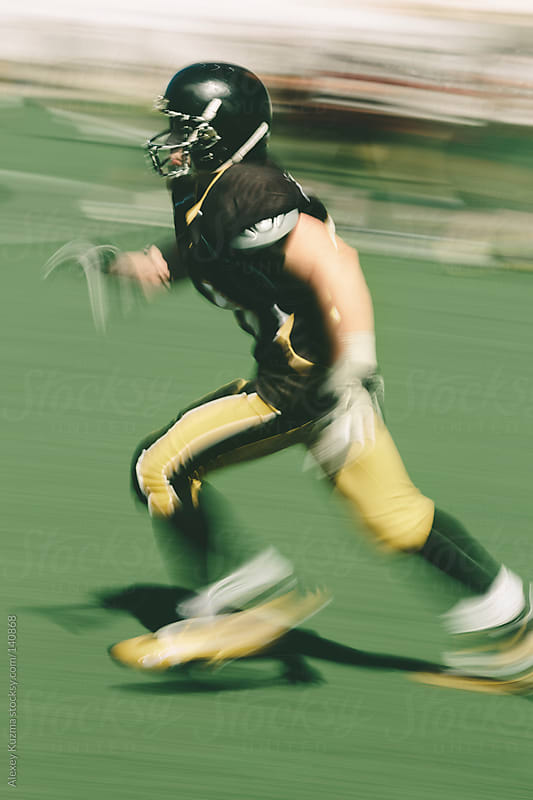american football player running by Alexey Kuzma for Stocksy United