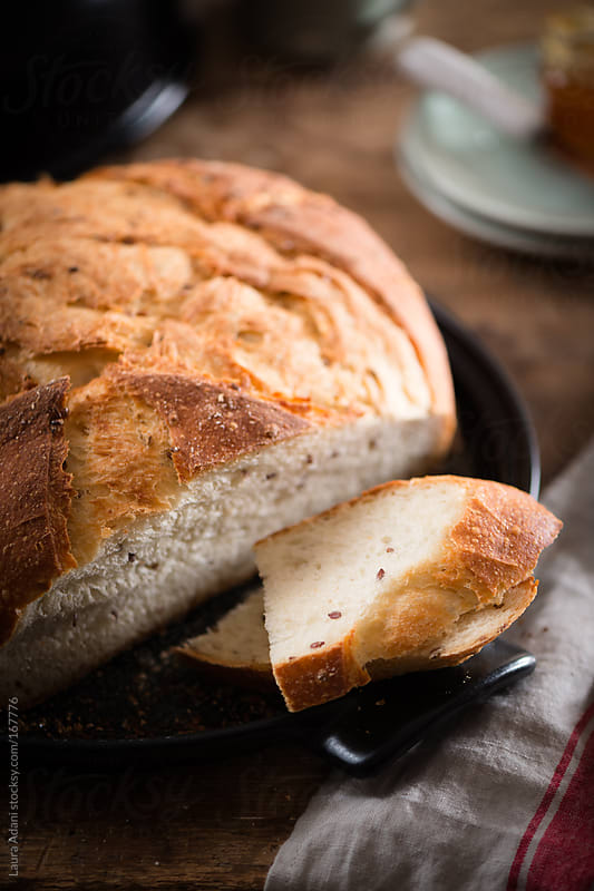 bread with flax seeds by Laura Adani for Stocksy United