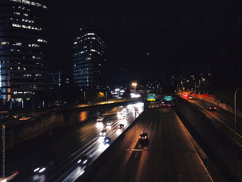 Long Exposure Night Shot of Traffic on I-5 Freeway in Seattle, Washington by Jared Harrell for Stocksy United