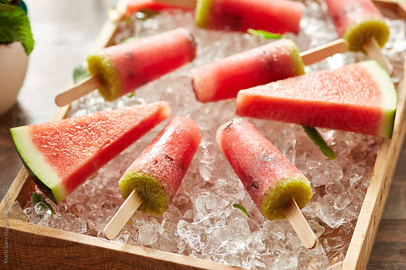 Watermelon popsicles on ice basket by Martí Sans for Stocksy United
