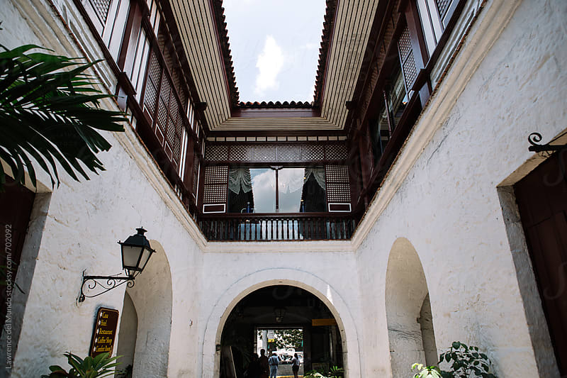 View of an old Spanish colonial era house from the driveway. by Lawrence del Mundo for Stocksy United