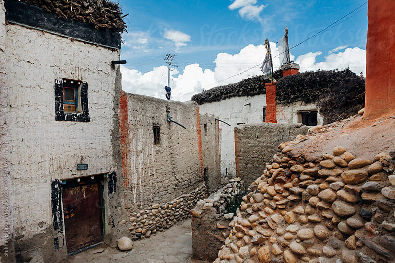 Walking along the alleys of Lo Manthang Village in Upper Mustang. by Shikhar Bhattarai for Stocksy United