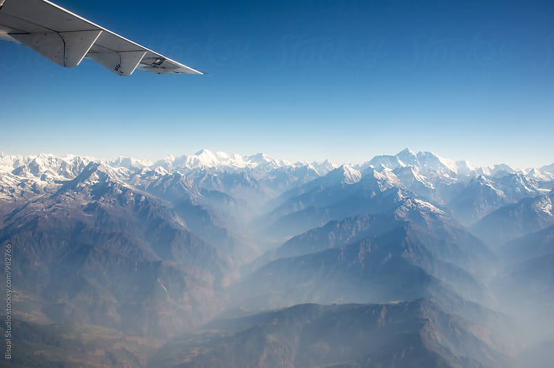 Views of Mount Everest and Himalayas front an airplane by Bisual Studio for Stocksy United