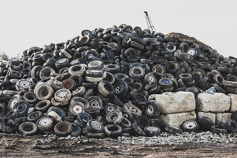 A pile of old tires by Richard Brown for Stocksy United