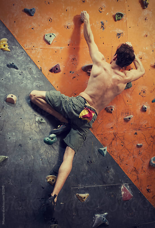 Man Free Climbing Indoors by Mosuno for Stocksy United