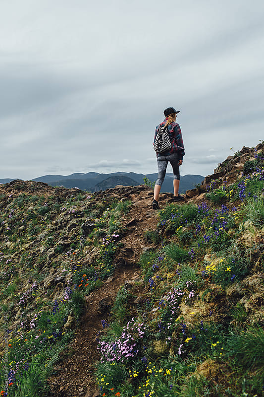 Woman Hiker on Mountain Trail by Evan Dalen for Stocksy United