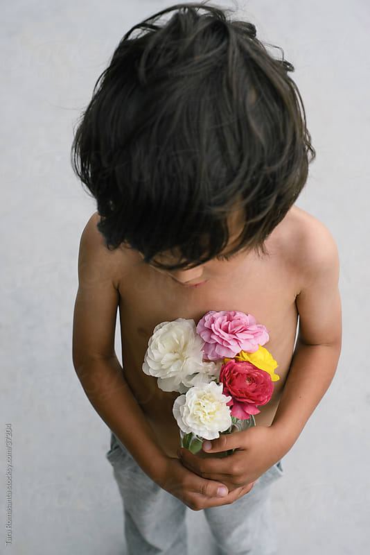 flowers for you, mommy: boy with bouquet by Tara Romasanta for Stocksy United