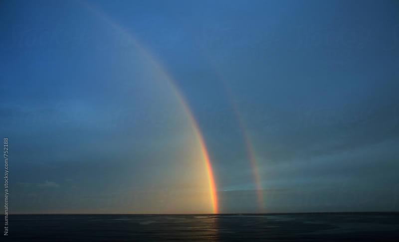 Double rainbow  by Nat sumanatemeya for Stocksy United