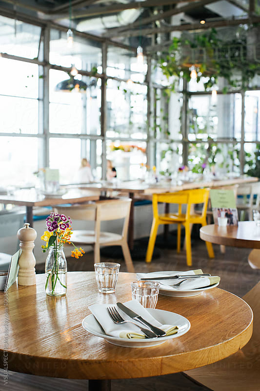 Set Table For Two in Stylish Bright Restaurant by VISUALSPECTRUM for Stocksy United