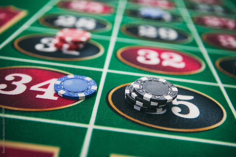 Casino: Chips On Various Numbers On The Roulette Table by Sean Locke for Stocksy United