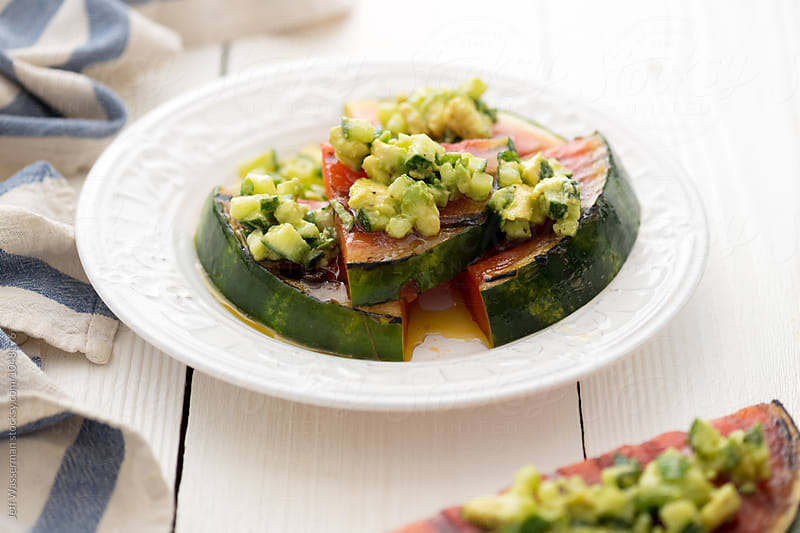 Grilled Watermelon with Avocado, Cucumber, Jalapeno salsa by Jeff Wasserman for Stocksy United