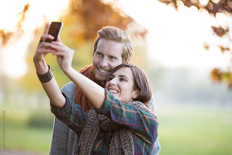 Couple Photographing Themselves Outdoors by Lumina for Stocksy United