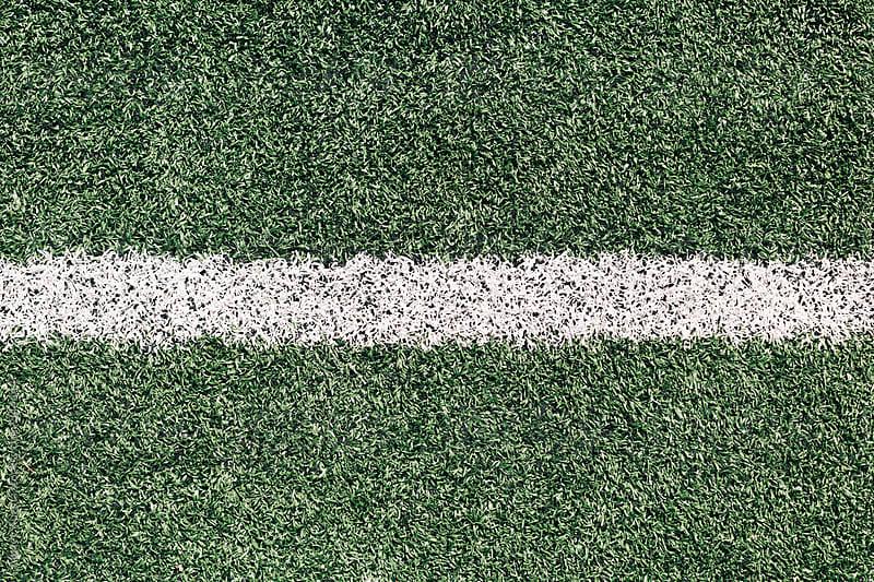 White line on grass sports field by Alexey Kuzma for Stocksy United