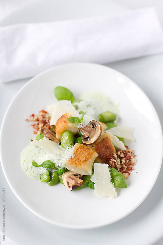 Gnocchi with fava beans and basil foam by Noemi Hauser for Stocksy United