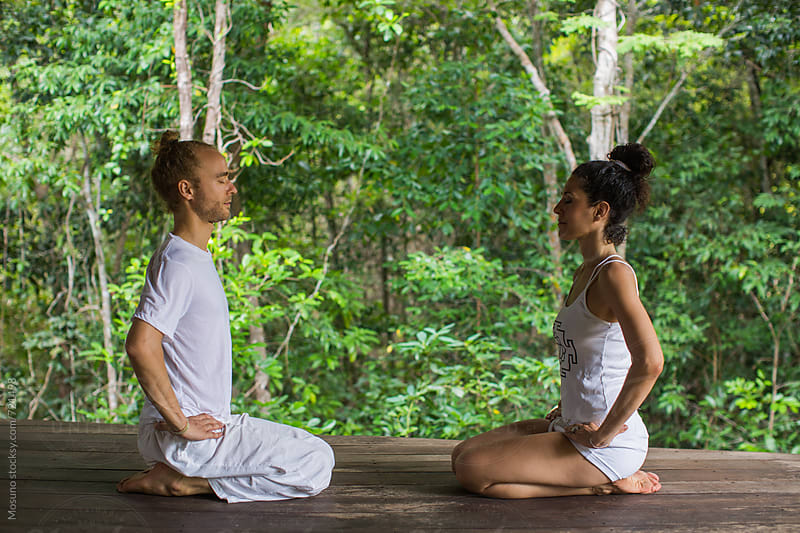 Two People Meditating Facing Each Other by Mosuno for Stocksy United