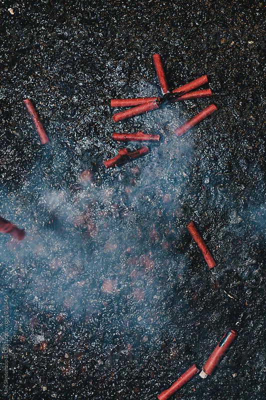 Exploding firecracker flying through the air by Urs Siedentop & Co for Stocksy United