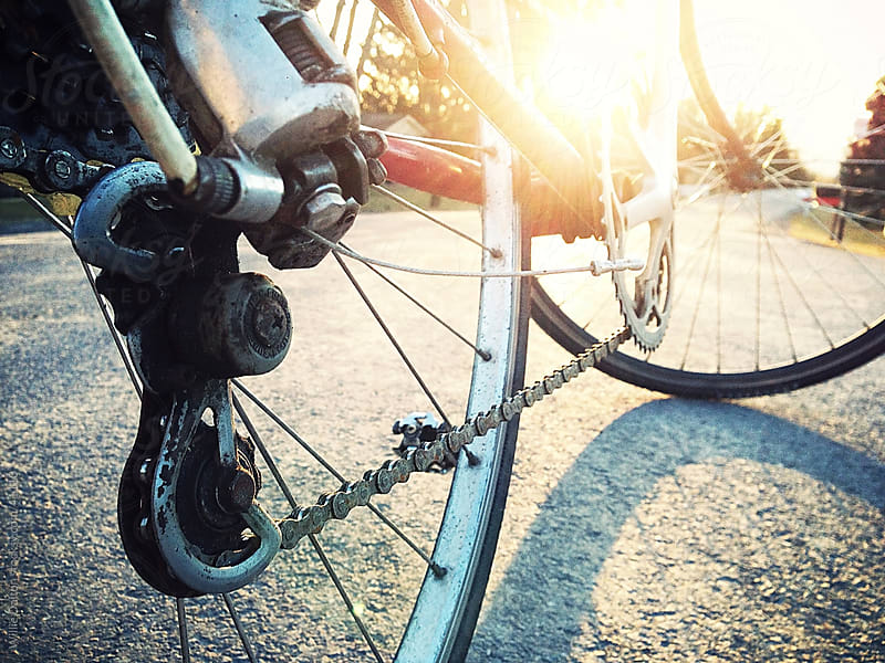Low-down Shot of Bicycle Wheels with Sunset  by Willie Dalton for Stocksy United