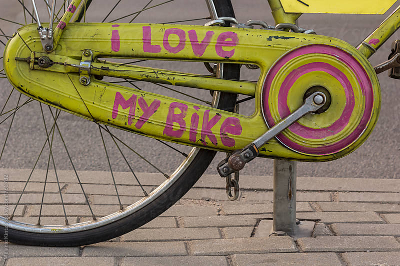 I love my bike written on the chain guard of a bicycle by Melanie Kintz for Stocksy United