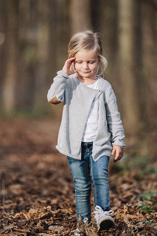 cute little girl in autumnal forest by Leander Nardin for Stocksy United
