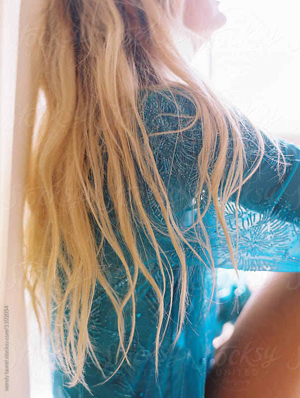Blonde girl in blue sequin dress with long hair by wendy laurel for Stocksy United