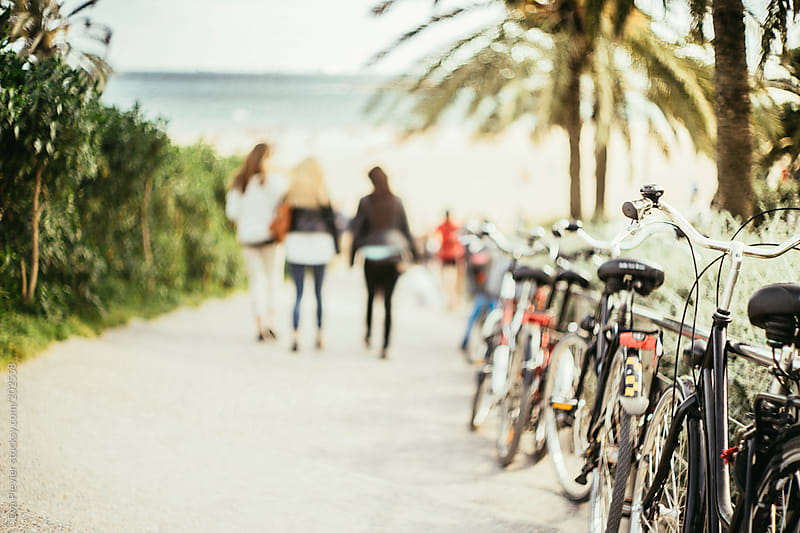 Bicycles parked by a fence along the shore. by Eva Plevier for Stocksy United