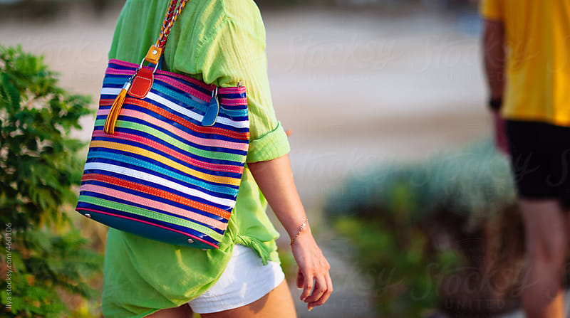 Young anonymous woman with multi colored summer bag closeup by Ilya for Stocksy United