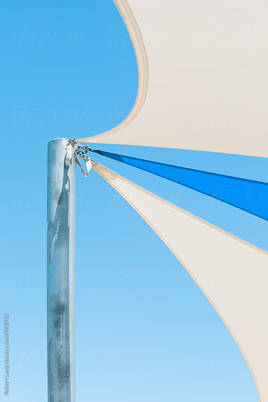 Blue and white shade sails by Robert Lang for Stocksy United