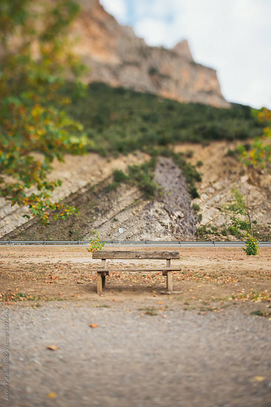lonely seat in the middle of the road by Javier Pardina for Stocksy United