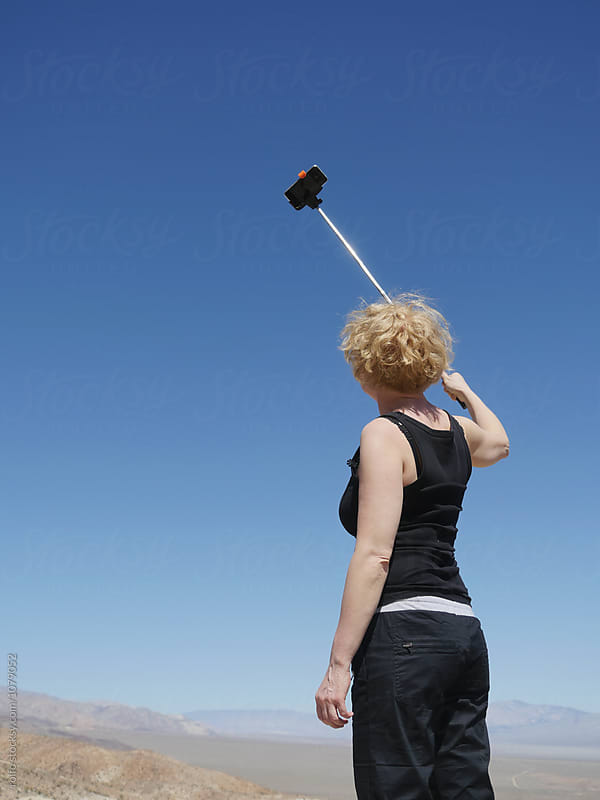 Back view of woman taking selfie by rolfo for Stocksy United