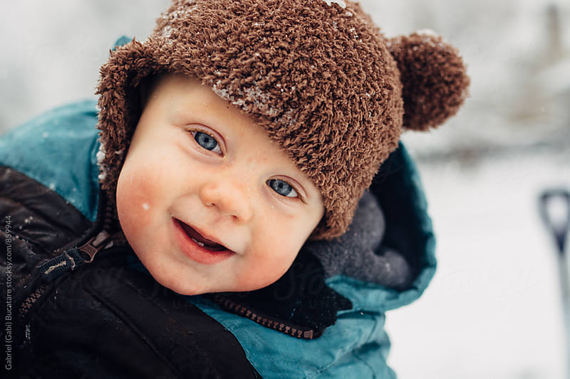 Cute smiling baby boy outside in the snow by Gabriel (Gabi) Bucataru for Stocksy United